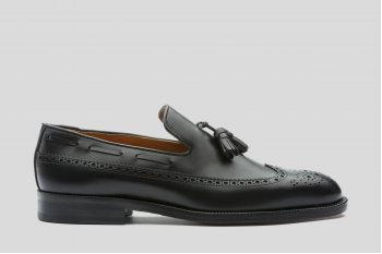 Black loafers with broguing